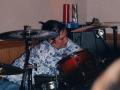 kate adjusting her drums
