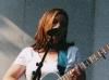 jill singing and playing guitar